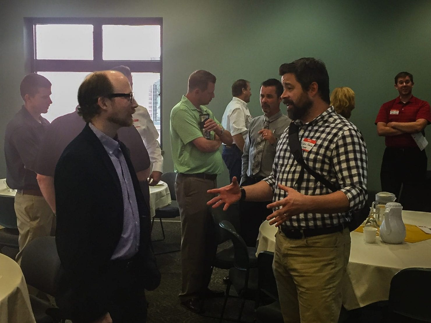 SCHEMMER'S BIM Manager, Josh Murphy (left), networks at the DBIA breakfast program.