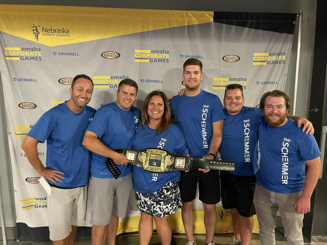 Omaha Corporate Games Top Golf Team with second place trophy